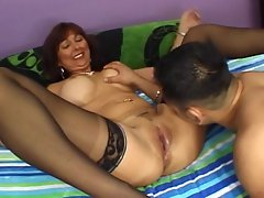 Redhead MILF Desi Foxx rides cock in her stockings