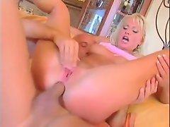 Cute blonde in pink lingerie has DP sex